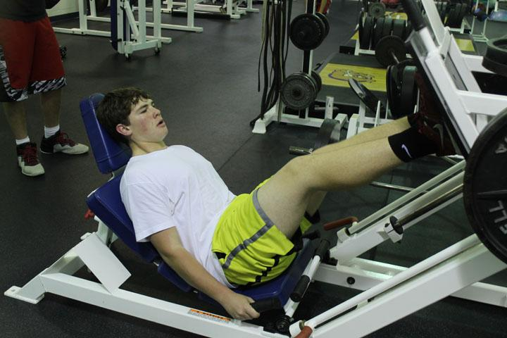 Josh Elliot working out in the weight room