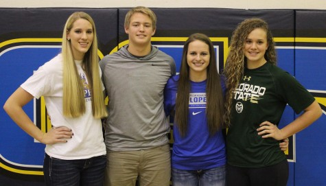 Dawgs, left to right, Josie Cox, Jayden Kruse, Allison Kuenle, and Olivia NIcholson sign with various next-level schools on National Signing Day