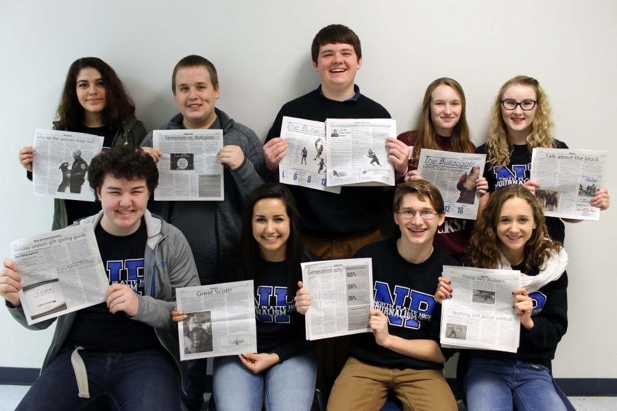 Bulldogger staffers hold copies of their winning JEA articles.