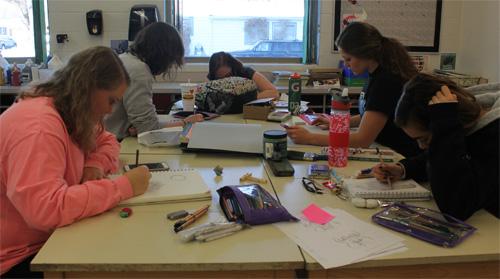 Advanced Drawing students Morgan Lashley, Kelly Fitzpatrick, Alex Sines, Mack Nelson, and Tea Guerra focusing on their work
