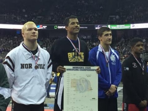 Sophomore Braiden Ruffin stands atop the podium at the State Wrestling tournament in Omaha, Nebraska on February 20, 2016