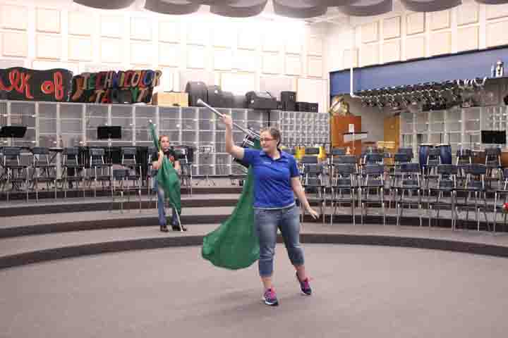 Sydnee Miller practices her routine before her color guard try-out last Wednesday.