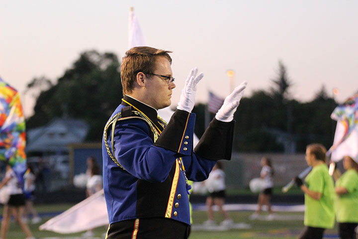 "Senior Taylor Blagdon leads the marching band at the homecoming half-time show on September 9. He's focused on directing the song but also on leading the band to a victory at State. ""I want us to have fun musically, be challenged, and learn, over focusing on getting a superior [at State],"" he said."