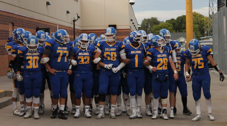 NPHS varsity football  players come together before taking the field against Lincoln Southwest September 30.