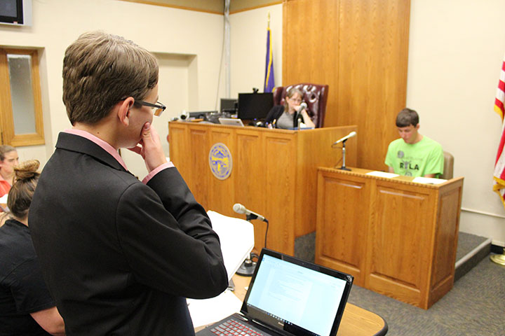 Nathan Franz as prosecution attorney, direct examining Officer Dylan Perkins played by Andrew Phares.