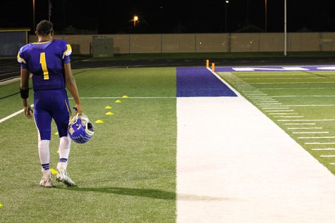 Senior Trevon Weaver stands alone on the sideline during the fourth quarter of the Bulldog's 59-12 victory against Omaha Bryan.