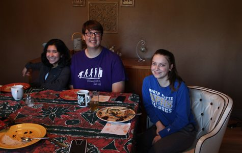 Juniors Allison Brogdon, Zac Oschner, and Nirvana Mendoza gather around the table. for their all vegan and gluten-free Thanksgiving dinner. They said they loved every bite.