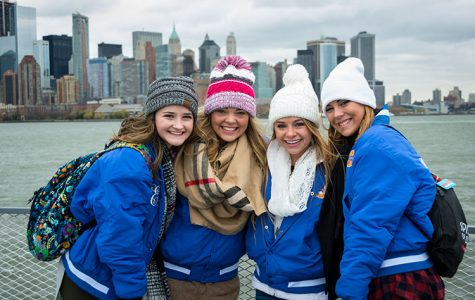 Libsack poses with other cheerleaders on their tour of Ellis Island.