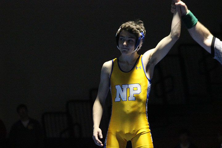 Jayson Scott smiles with pride after winning his match against Scottsbluff.