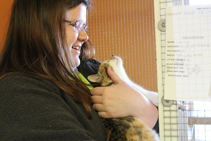 Zoey Hall giving her undivided attention to every kitten as much as possible. She opens every kennel to play with each individual cat, and sometimes at the North Platte Animal Shelter if they let her, she will let her scoop them up to be cuddled.