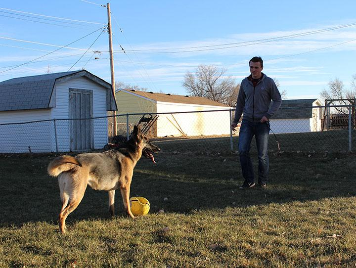 Dowhower plays soccer with his German Shepherd Alexis during a chilly December afternoon to have fun and stay in shape. He plays with her nearly every day, even when the weather is cold.