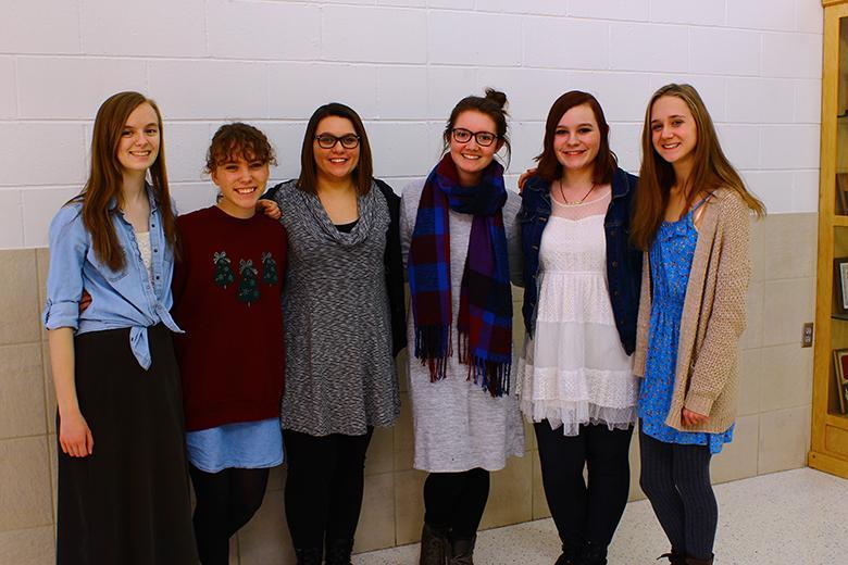 (L-R) Emma Downey, Mara Strecker, Rebekah Littrell, Megan Wullschleger, Keleeann Littrell and Syble Heffernan posing in their dresses on the 21st day of Dressember.