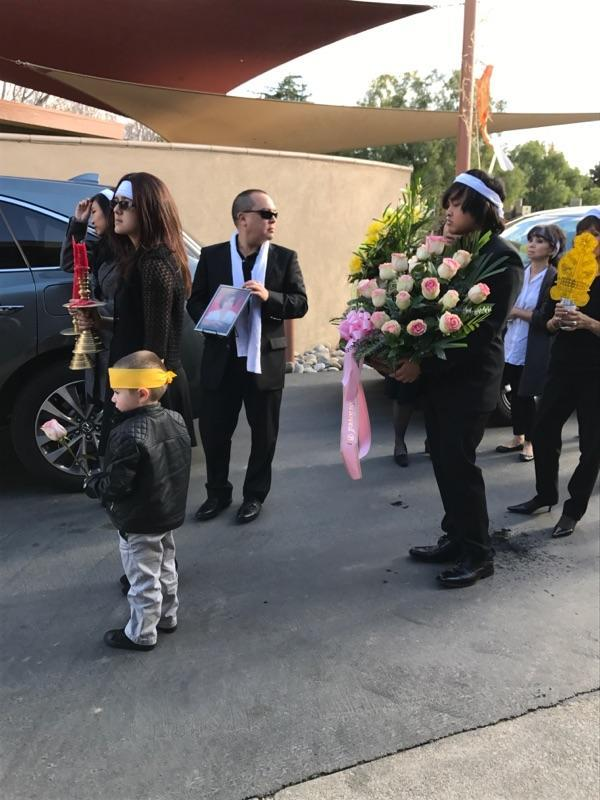 Sansone+and+her+family+lined+up+in+a+procession+during+the+funeral.