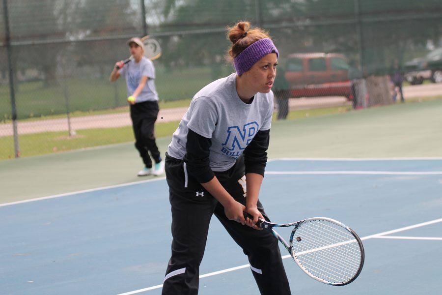 Jordynn Simpson returns a volley during tennis practice.