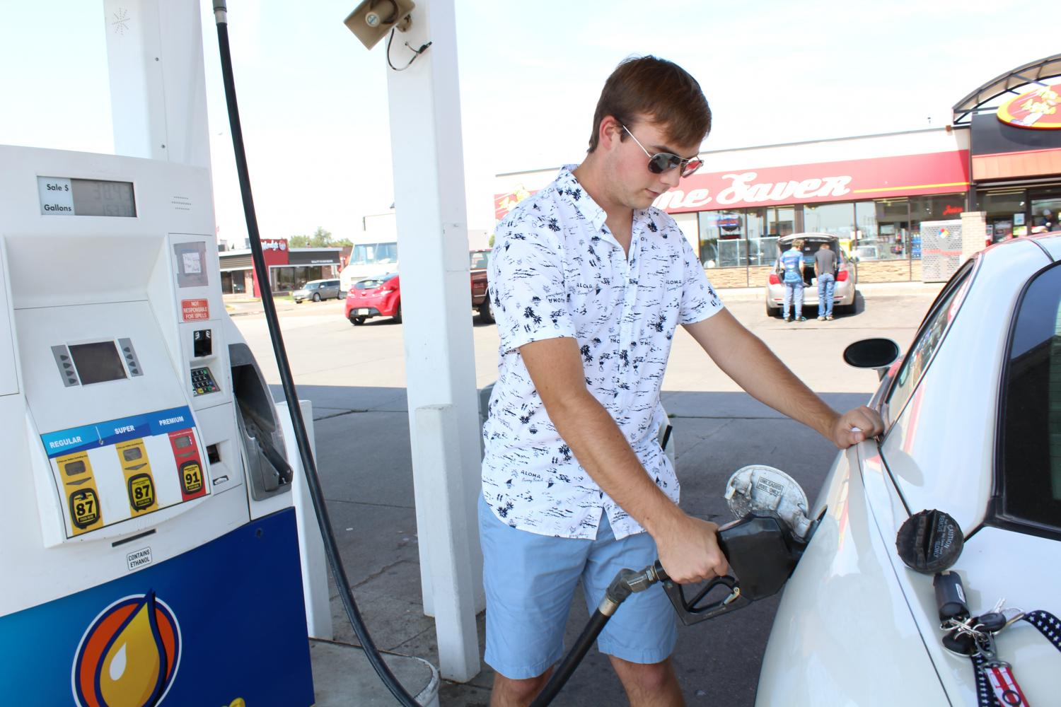 Junior Jake Gutschenritter filling up on gas at Time Saver. A full tank used to cost around 35 dollars for him. Now he pays on average 38 dollars.