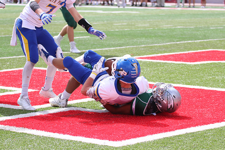 Junior Aidan Arensdorf is Pulled down by a Lincoln Southwest player after an interception.