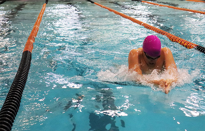Senior Zane Leibhart will leave his permanent mark after breaking the school record in the 100-yard breaststroke at the McCook Swim and Dive Invitational on Dec. 8.