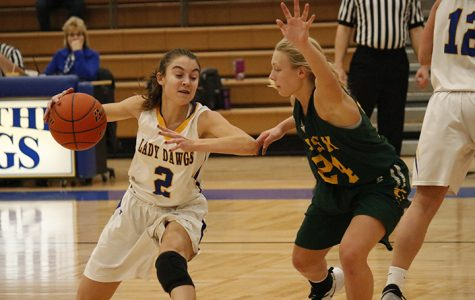 Haneborg guards the ball while trying to make a pass.
