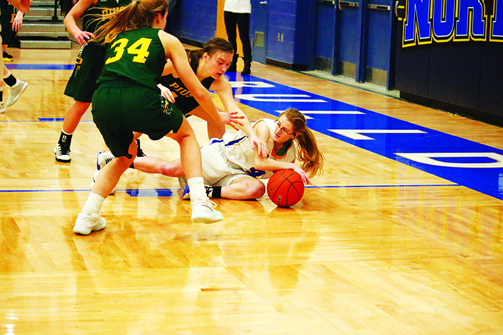Senior Kathy Mathieu guards the ball after being knocked down.