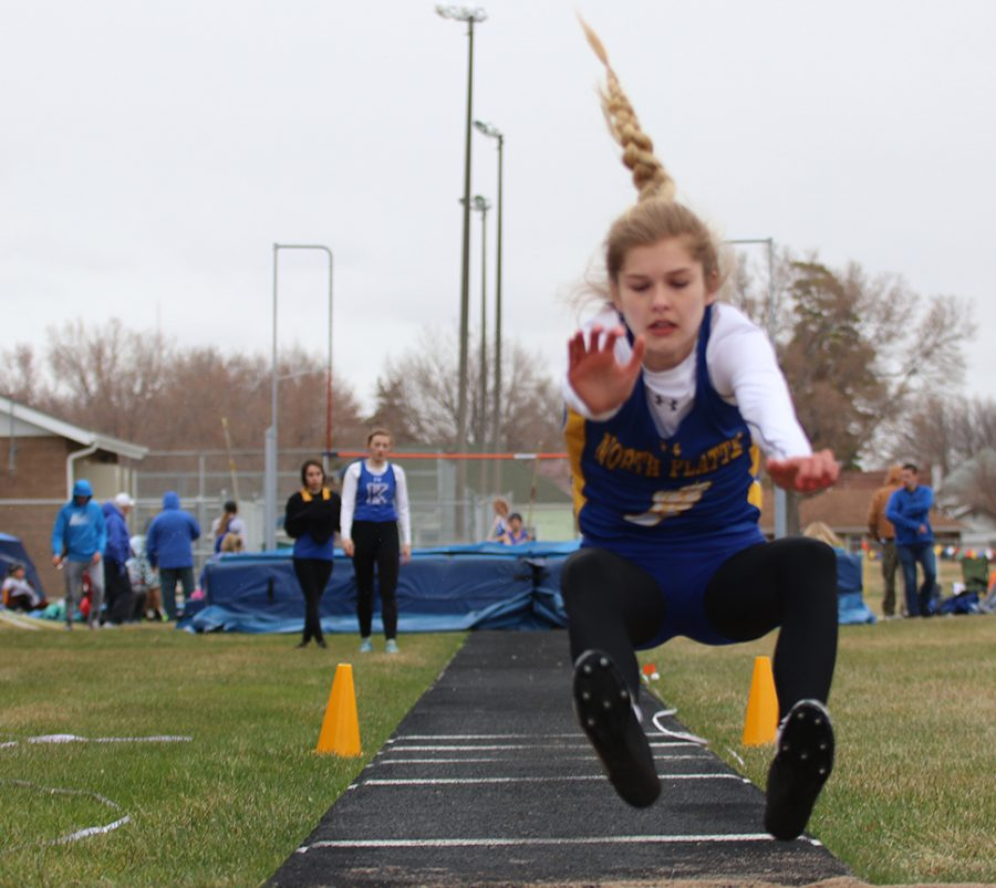 Freshman Peyton Neff competes in triple jump at the NPHS Buffalo Bill Track Invite.