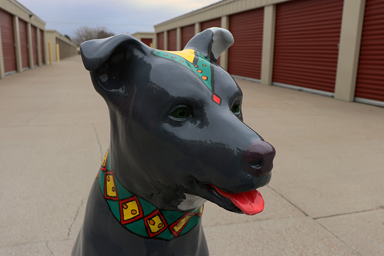 Waf, the dog sculpture painted by North Platte High School Art Club students, Gillian Allen, Jakob Fischer, Sophia Walsh, and Tori Randolph. They painted him with an Aztec theme in mind, which is reflected the most on his harness.