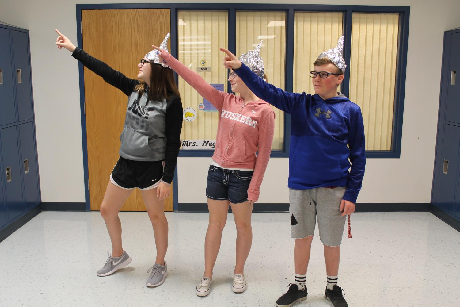 Freshmen Bubba Nelson, Emmalynn Berry, and Jorey Skinner protecting their brains from aliens as they wait for the world to end.