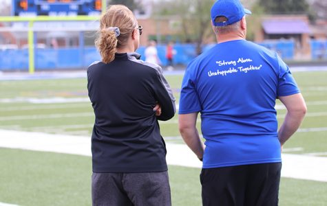 NPHS Coaches, Sarah Kaminski and Brian Jahnke, are positively influenced by their athletes during practices, games, and meets. Photo by Gracia Lantis