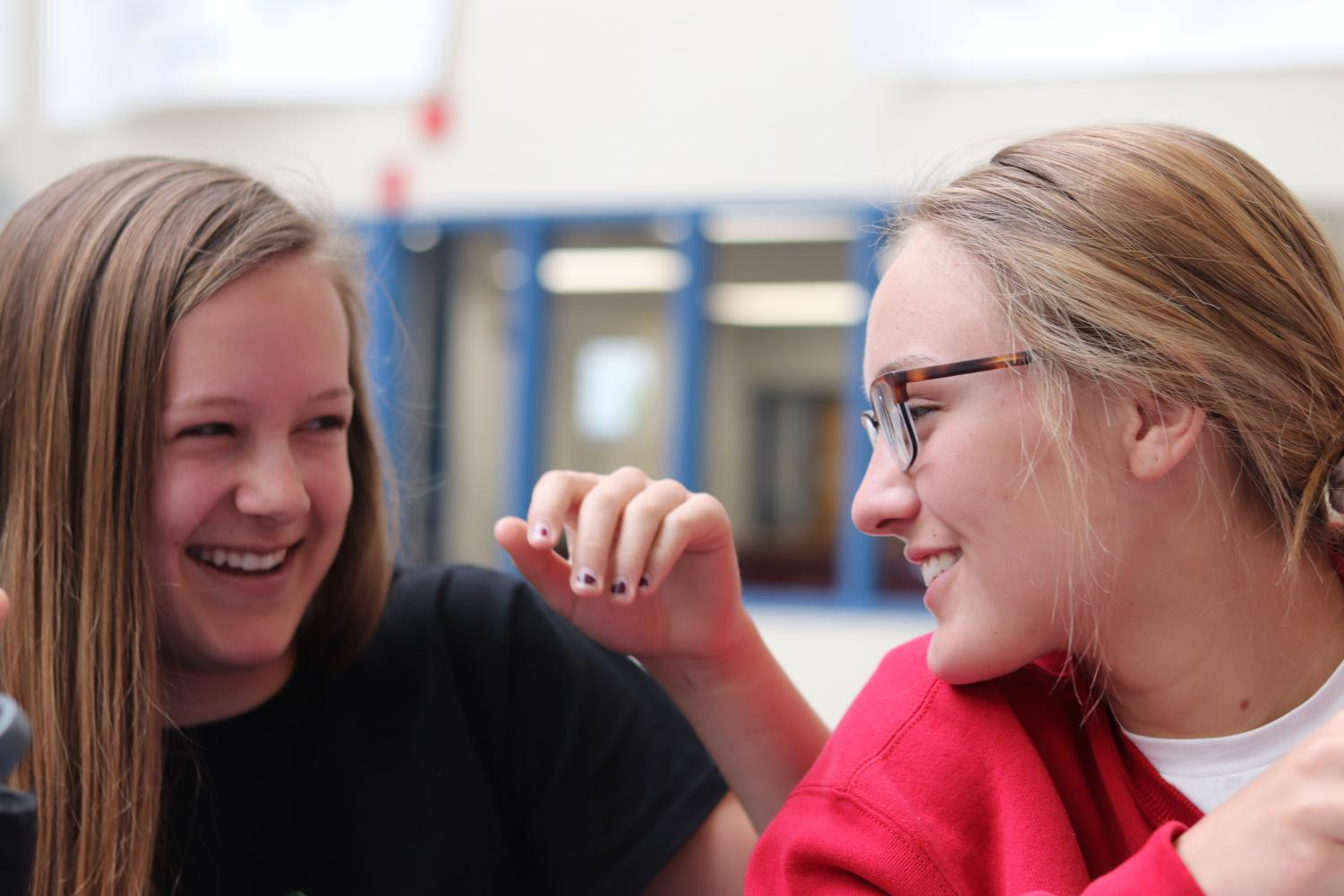 Freshmen Gracelyn Cauffman and Shelby Yoshida share a laugh during their lunch. Photo by Sophia Chingren.