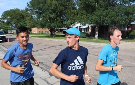 Coach Jake Hasenauer (right) builds relationships with his athletes  as he runs along side them.
