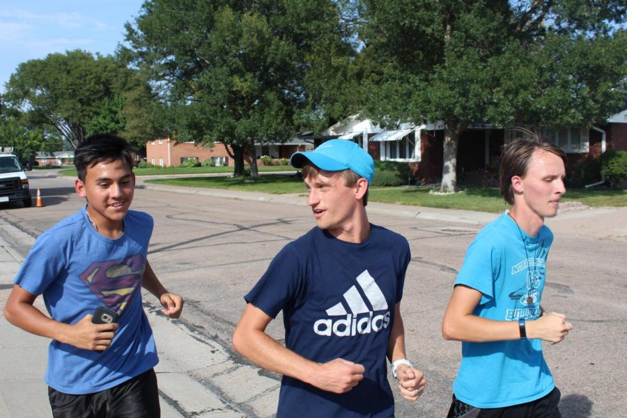 Coach+Jake+Hasenauer+%28right%29+builds+relationships+with+his+athletes++as+he+runs+along+side+them.