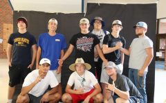 Seniors Drew Phillips, Max Hayes, Keifer Smitty, Jake Johnson, Zach Kring, Brycen Tophane, Jonathan Edwards, Jacob Tobey, and sophomore Callen Zurn pose in their unofficial homecoming theme hats.