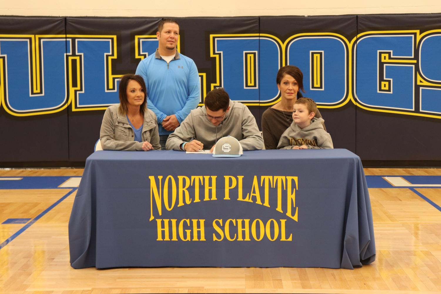 Caden Comer ('18) signs to Southeast Community College last year.