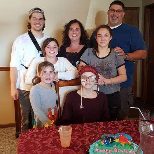 The Girard family gathers around a table in celebration of Abbey's 13th Birthday on Nov. 20, 2016.