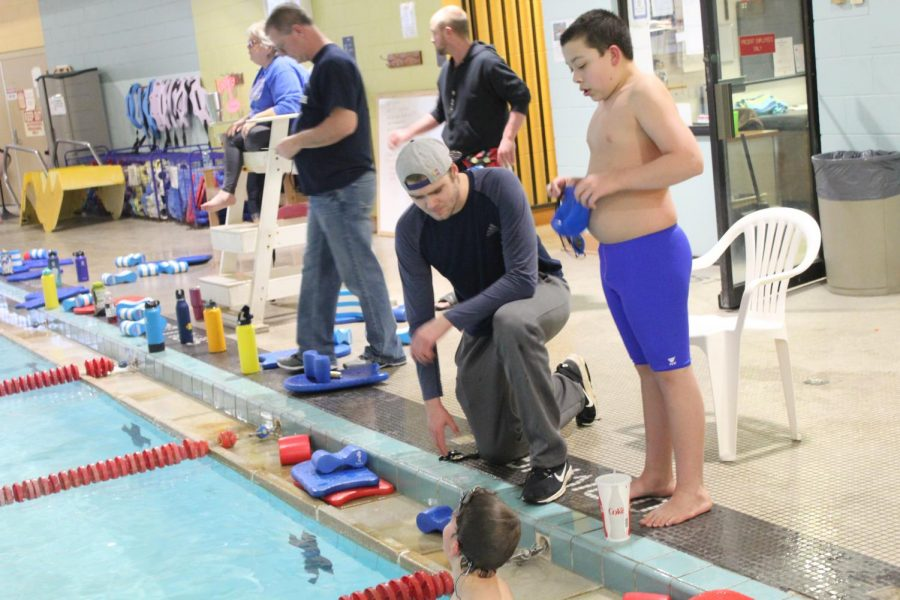 Dec.+1%2C+2018%2C+the+first+swim+meet+of+the+season+finds+Heffernan+not+fully+healed.+He+turns+to+coaching+the+younger+club+groups.