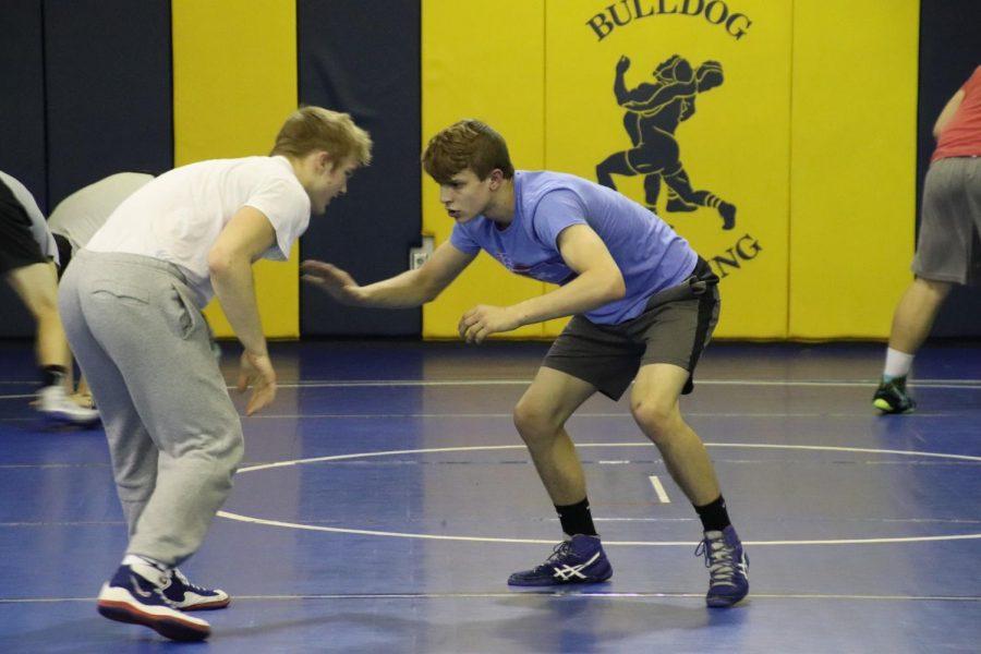 Sophomore Gavyn Brauer and freshman Luke Rathjen practice handfighting.