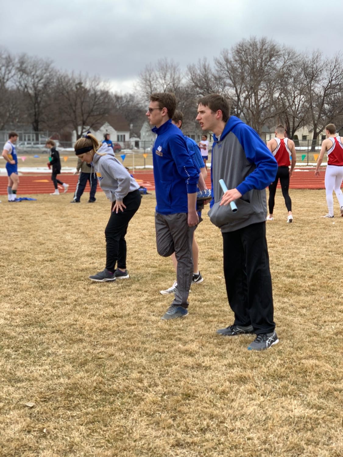 Seniors Nathan Franz and Jared Gies and sophomore Shelby Yoshida warm up before a race, at their first meet in Scottsbluff on Saturday, March 23. The three of them also participated in Unified Bowling in the fall. Photo courtesy of Nathan Franz.