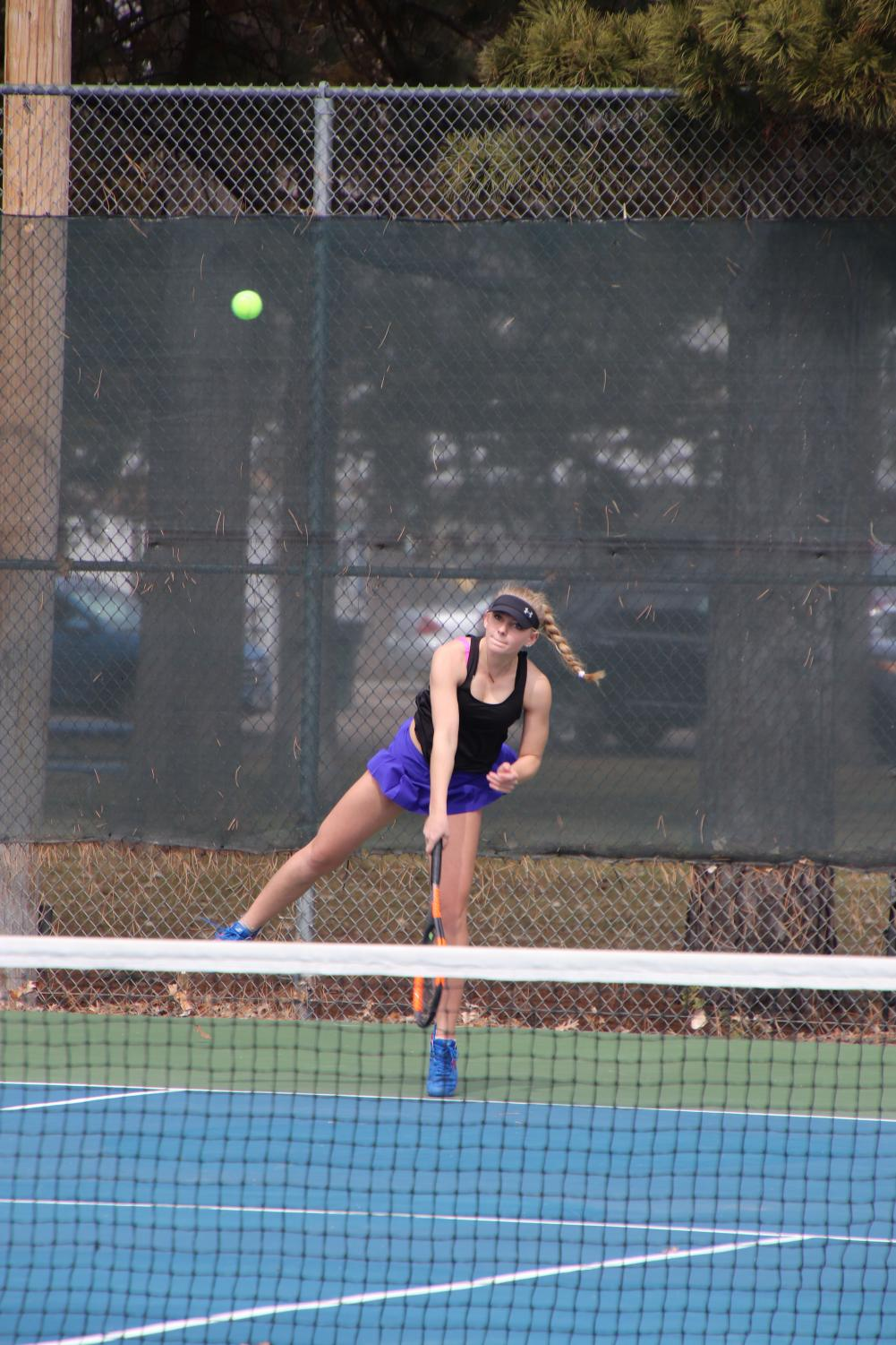 Senior Codi Guerrieri hits her first serve against Hershey on March 26. North Platte placed second as a team in this home meet.