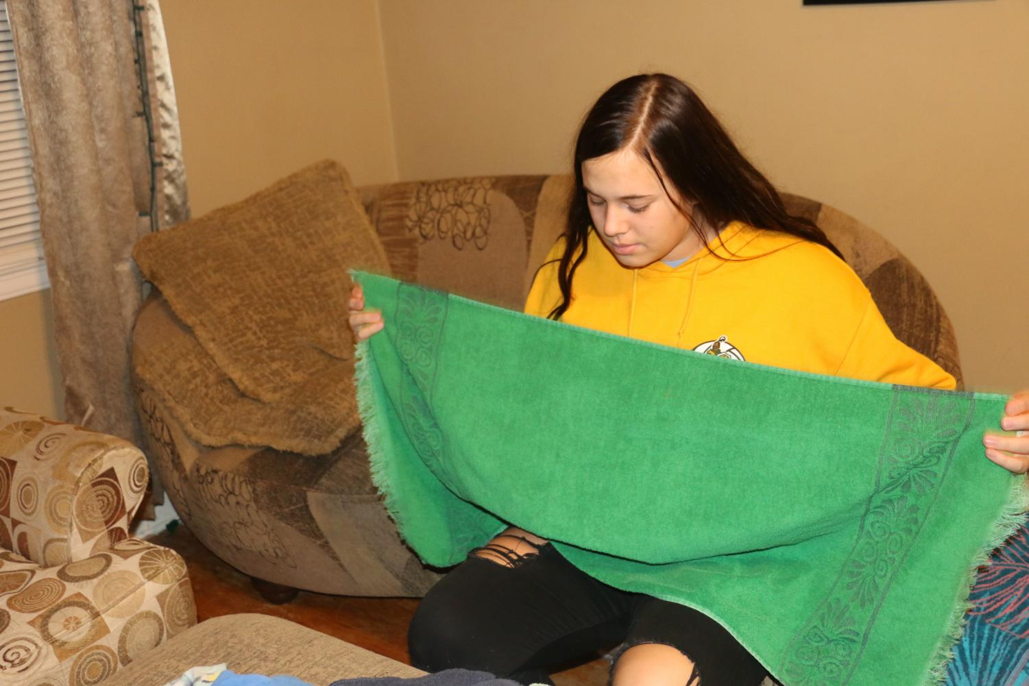 Sophomore Hillary Menghini does laundry at home. Chores are just a small part of this teens busy day.
