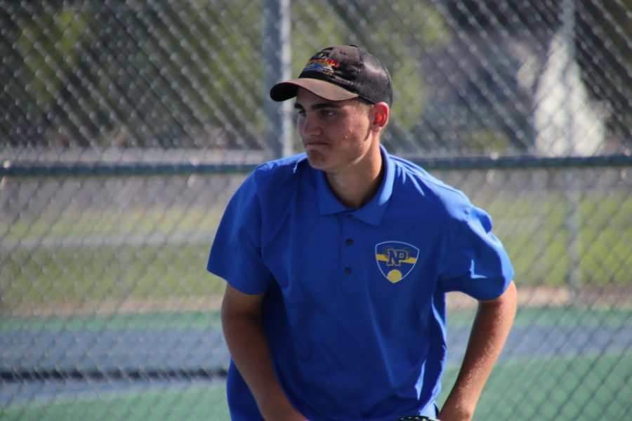 Bergeron finishes his serve, during the dual against McCook, on September, 24