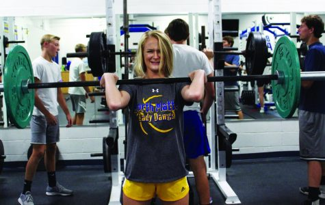 junior Jessica Mathieu pushes through her hang cleans, she lifts in weights class and is involved in Track.
