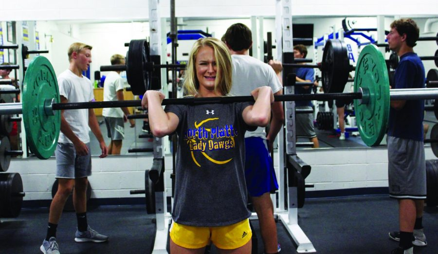 junior+Jessica+Mathieu+pushes+through+her+hang+cleans%2C+she+lifts+in+weights+class+and+is+involved+in+Track.
