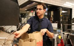 """Junior Will Kramer working the night shift at McDonald's. """"I like the challenge of running around and covering three positions, but inside you're mentally screaming,"""" he said."""