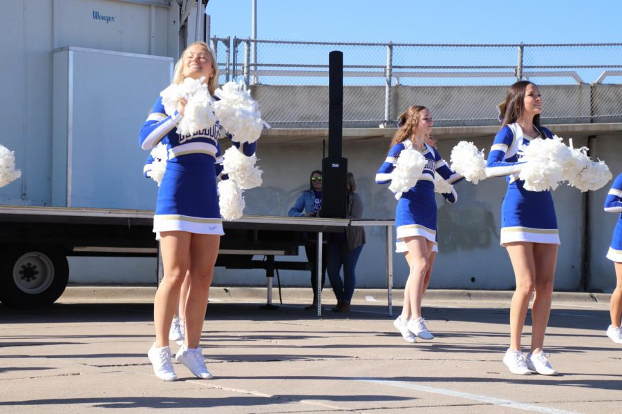The North Platte High School Cheer Squad is cheering on the school at the community pep rally Oct. 24, 2019.