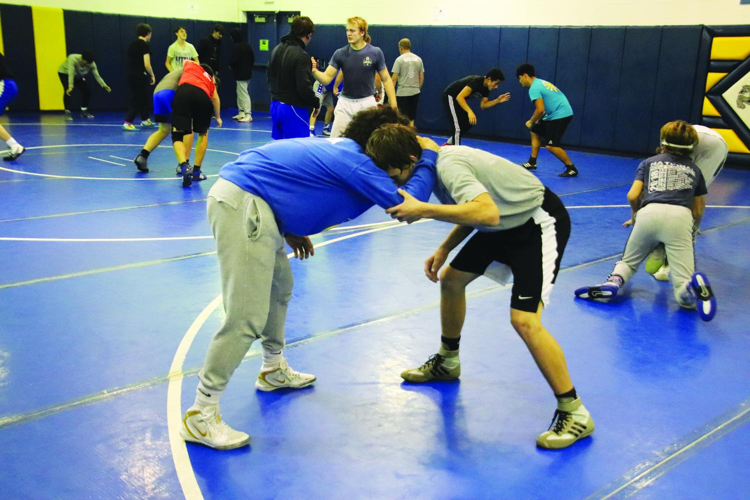 Two wrestlers tie up at the first practice of the season at North Platte High School on Nov. 18.