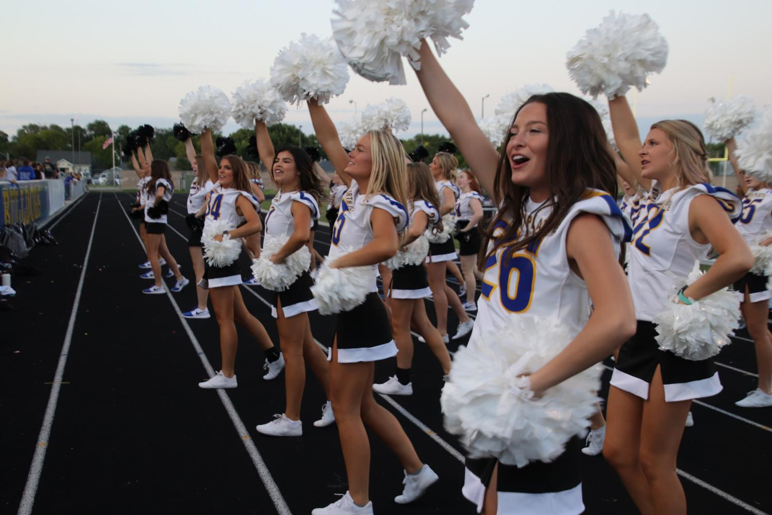 Cheerleaders encourage the football team during their annual homecoming game. The game took place on September 13th. Football player Zayden Guenin said,