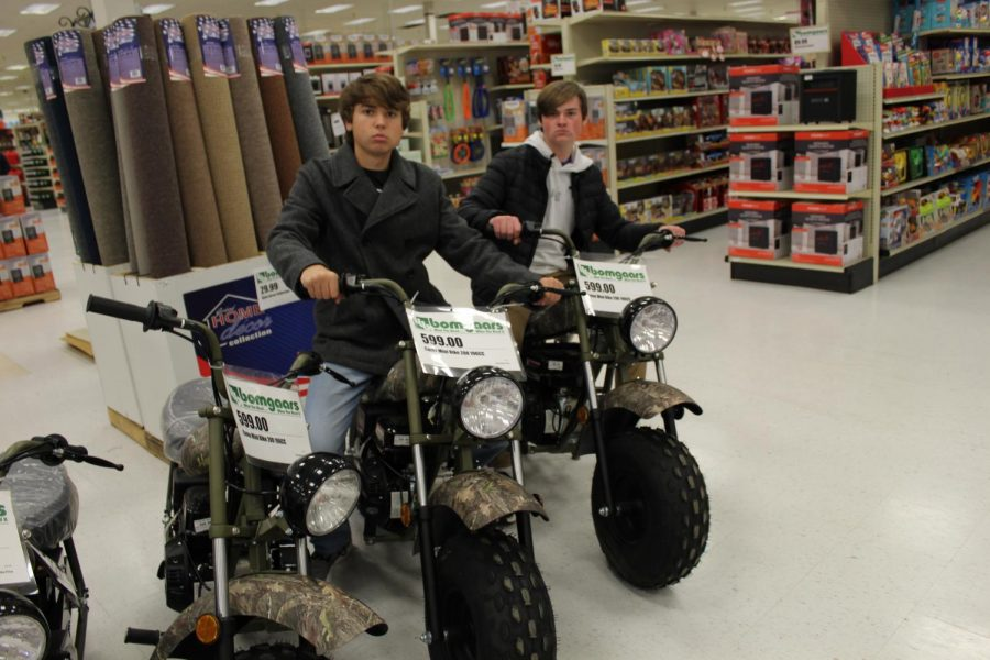 Sophomore Bulldogger writers Beckett Allen (left) and Joe Stone check out the minibikes at the new Bomgaars in North Platte.