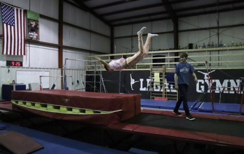 Jackson Erickson does a warm up flop onto a mat at Legacy Dance and Gymnastics on Nov. 1. Legacy has recently started to host an open gym at their studio every other Friday that's available to anyone.