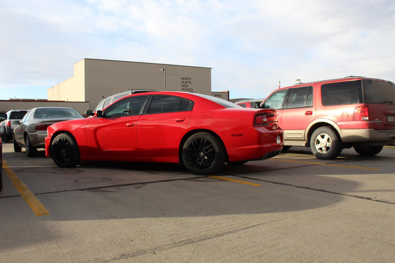 A student car takes up multiple spaces in North Platte High School's parking lot on Nov. 13.  The parking trend started last year but has gained attention over the last week.