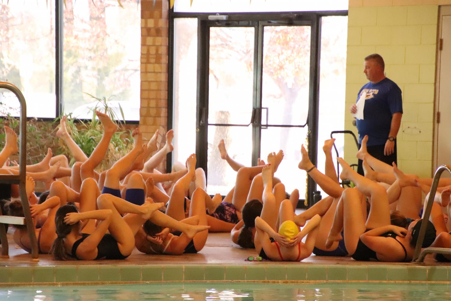 Swimmers and Divers warming up for the very first practice of the season.