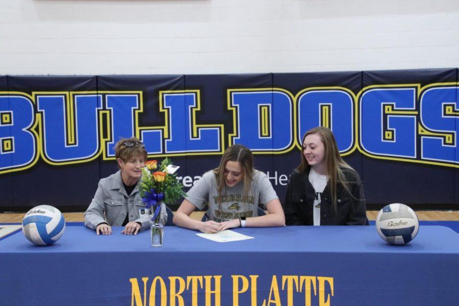 Kelsey Salazar-Allen signing her college contract for volleyball at Nebraska Wesleyan.